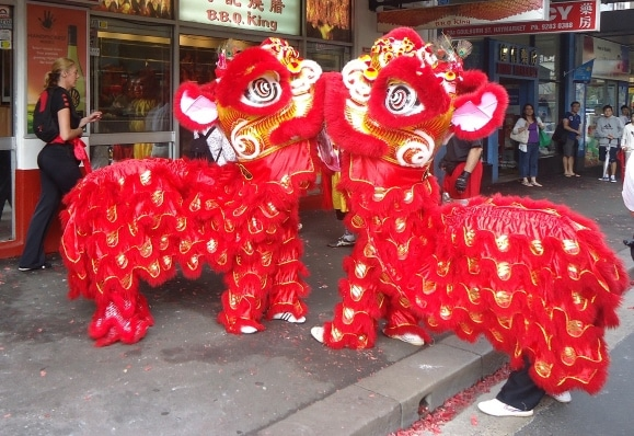 Lions bowing during lion dance