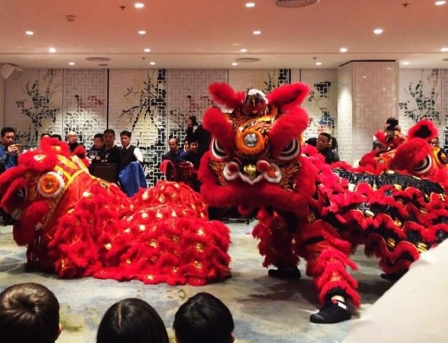 Lion dance performance at a Chinese restaurant